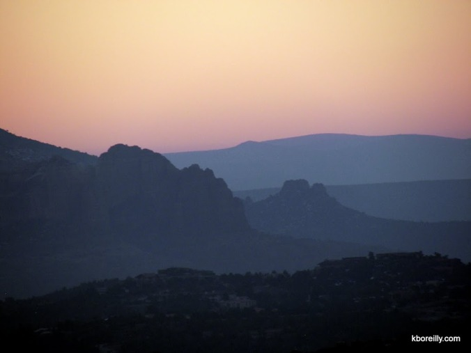 The sun rises over the red rocks of Sedona, Ariz.